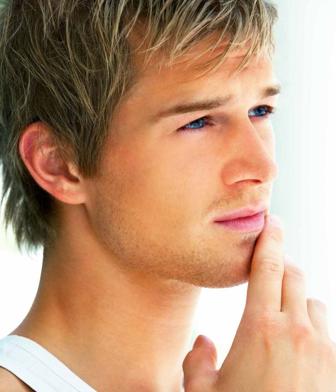 Closeup portrait of a handsome young man looking away