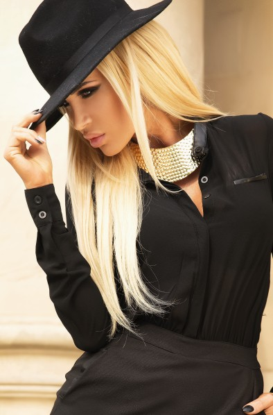Portrait of beautiful young blonde woman with fashionable hat.